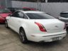 rear view of Jaguar XJ with tinted windows