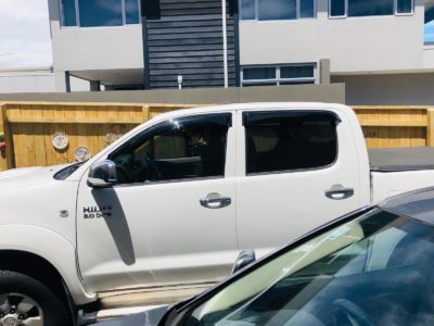 Exterior of window tinting on Toyota Hilux